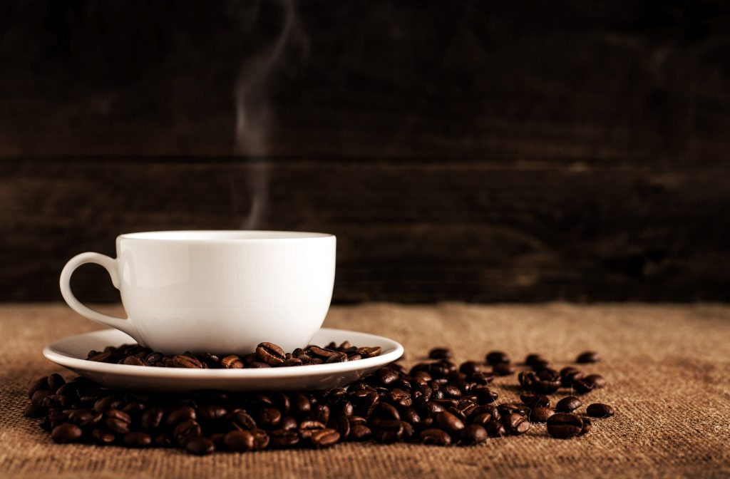 coffee-beans-steaming-cup